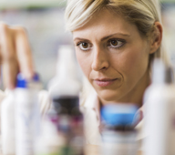 Pharmacist looking at pill bottles and choosing what to take.  [url=http://www.istockphoto.com/search/lightbox/9786662][img]http://dl.dropbox.com/u/40117171/medicine.jpg[/img][/url]